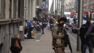 Belgian security forces respond to blast as injured are treated outside metro station