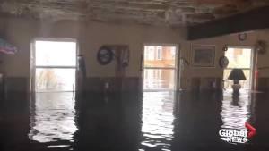 N.B. resident takes Global News reporter on canoe through flooded home