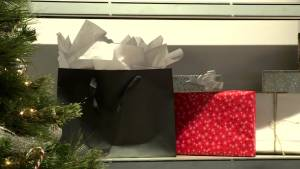 Outlet mall gift wrapping station raising money for United Way