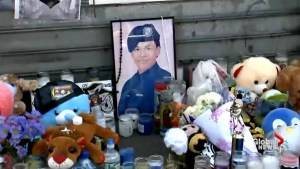 Community lays candles, flowers in impromptu vigil for slain Bronx teen