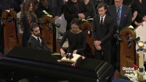 Celine Dion lays flowers on casket of husband René Angélil