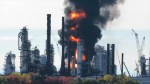 Flames billow into air as Irving Oil refinery fire rages