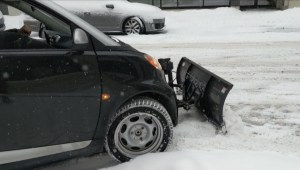 Montrealer's Smart car doubles as a snow plow