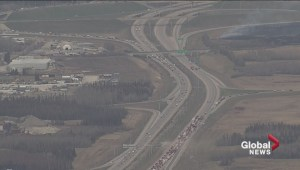 Grass fire and crash on Henday in west Edmonton