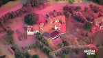 Aerial video shows homes drenched in pink fire retardant following Woolsey Fire