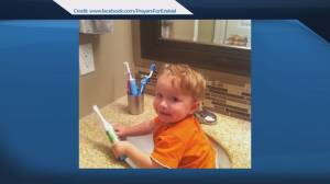 911 call made by parents of boy who died of meningitis (01:49)