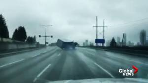 Dash cam video shows truck losing control on Highway 1