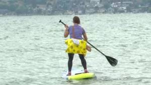 Teams paddleboard to raise funds for brain injury prevention programs