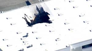 Authorities say F-16 fighter jet crashed into warehouse in California at Air Reserve base
