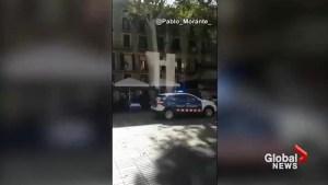 Amateur videos show people fleeing the scene, seeking shelter following Barcelona van incident