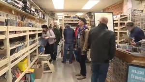 A much loved Kingston business owner reopens after major flood