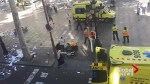 Paramedics treat victim of Barcelona van attack