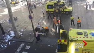 Paramedics treat victim of Barcelona van attack