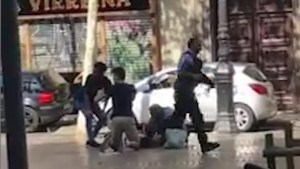 Video shows police running towards scene of Barcelona attack, victims being treated