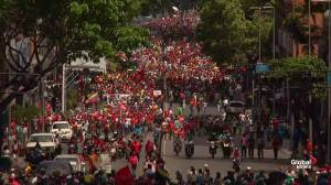 Pro-Maduro supporters march through the streets of Caracas