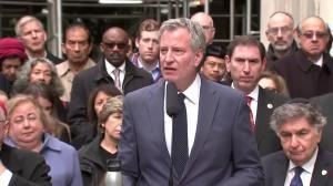 New York mayor says centres of worship no place for 'armed guards'