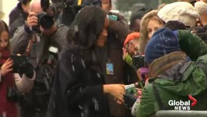 Prince Harry and Meghan Markle brave the snow to greet fans during royal visit to Bristol
