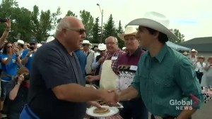 PM Justin Trudeau serves up pancakes at the Marda Loop Stampede breakfast in Calgary