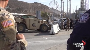 U.S. Marines lay barbed wire barricades at US/Mexico border entry point