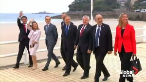Ministers take a stroll on beach as 'yellow vests' protest G7 meeting