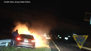 'Your car's on fire bro!': Police pull unconscious man from burning vehicle
