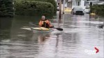 Man kayaks through flooded streets of Quebec village