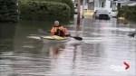Man kayaks through flooded streets of Quebec village