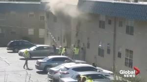 Construction workers catch children thrown from burning building in New Mexico