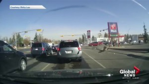 Dash cam captures light poll blown over during Calgary windstorm