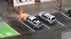 Parked truck engulfed in flames