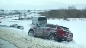 Snowy weather sends cars into Calgary ditches