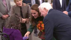Kate Middleton presented with flowers upon arrival at Whitehorse International Airport