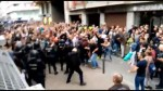 Shots fired as police clash with voters outside Spanish polling station