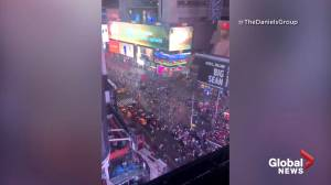 Mass panic in New York City's Times Square a result of a motorcycle backfire: police