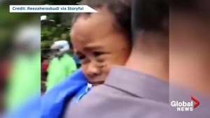 Indonesia police rescue child from rubble after deadly tsunami