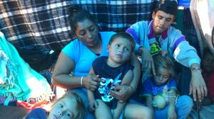 Mother in migrant caravan describes running from tear gas launched at U.S. border