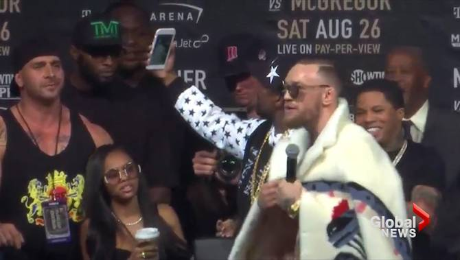 Boxer Wearing Chain Into Ring