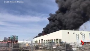 Massive fire sends plumes of black smoke into sky over south Edmonton industrial area