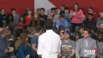 Trudeau brushes off woman's question during town hall event in Regina