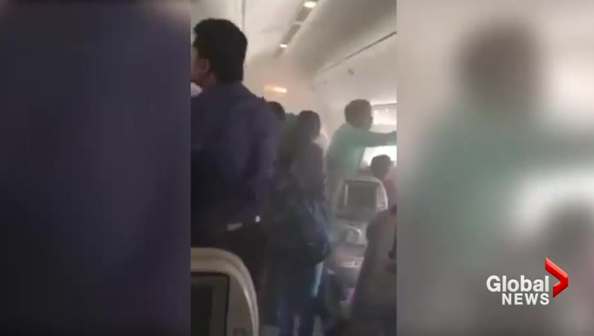 http://Video%20captures%20confusion,%20panic%20as%20Emirates%20passengers%20told%20to%20'leave%20bags%20behind'