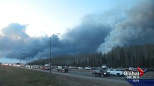 Fort McMurray wildfire: Residents flee the community