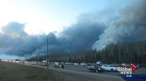 Fort McMurray wildfire: Residents flee the community (01:39)