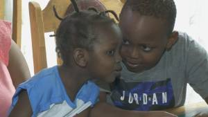 Exclusive: Refugee family recounts escaping townhouse fire