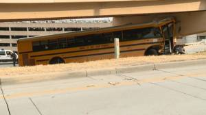 1 dead after school bus carrying high school football team crashes