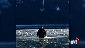 Ice drummer serenades skaters on frozen lake near Banff