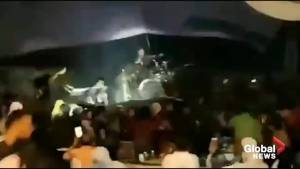 Video appears to show tsunami hit as Indonesia pop band performs