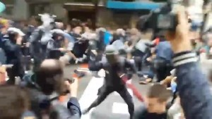 Police use batons to disperse crowd in Barcelona after referendum vote violence
