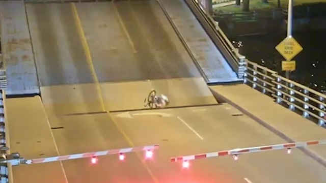 Bicyclist gets stuck in drawbridge after riding through gates