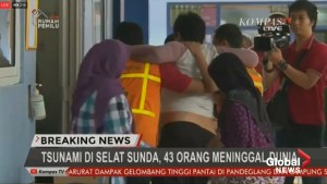 People evacuate, injured get treatment after volcano-triggered tsunami hits Indonesia