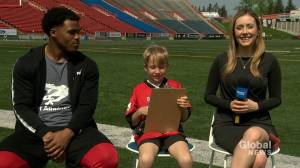 Junior reporter Ford interviews Stamps running back Don Jackson